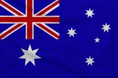 Inscription de l'Australie sur les mains des enfants dans la perspective d'un drapeau de ondulation de l'Autriche illustration libre de droits