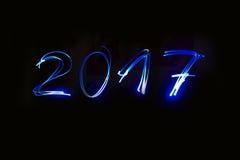 Inscription de la nouvelle année avec la pyrotechnie Image libre de droits