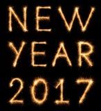 Inscription de la NOUVELLE ANNÉE 2017 dessinée avec les étincelles bengali Photographie stock libre de droits