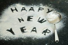 Inscription 2017 de nouvelle année de farine sur la table Photos stock