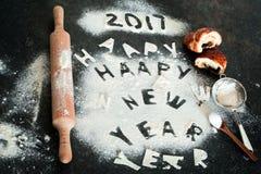 Inscription 2017 de nouvelle année de farine sur la table Photographie stock libre de droits