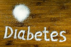 Inscription diabetes on the table stock photos