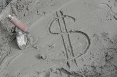 Inscription the dollar  on cement with trowel.  Royalty Free Stock Photography
