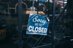 Inscription on a door: Sorry we are closed. Conceptual photo or table on door with information of work. Announcement or. Work schedule Royalty Free Stock Photos