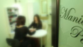 Manicure Pedicure 3. The inscription on the doors to the rooms cosmetology, manicure, pedicure, children`s room stock video footage