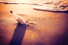 Inscription dream on sand Stock Photography