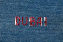 Inscription Dubai, inlaid rhinestones on denim. Stock Photo