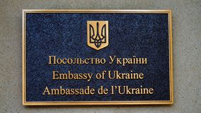 Inscription The Embassy of Ukraine written in different languages royalty free stock photos