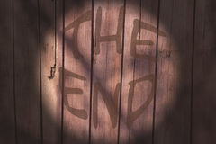 Inscription the end on a background of old wooden planks Stock Photos