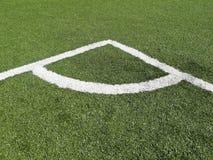 Inscription faisante le coin sur le terrain de football photo stock