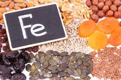 Inscription Fe and natural healthy ingredients as source iron, vitamins, minerals and dietary fiber. Inscription Fe and natural healthy ingredients or products royalty free stock photography