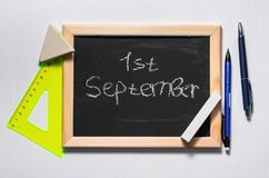 The inscription `the first of September`. On a chalkboard Stock Photo