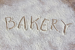 The inscription on the flour:Bakery. The inscription on the flour: Bakery on a wooden board Royalty Free Stock Photography