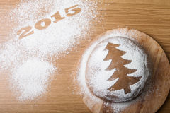 Inscription 2015 on flour and Dough patterned Christmas treeon a Royalty Free Stock Images