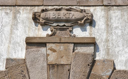 Inscription freedom on the bas-relief of a dilapidated ancient b Stock Images