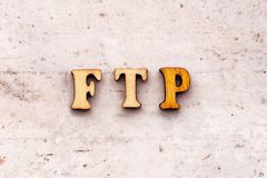 Inscription ftp File Transfer Protocol abbreviation in wooden letters on a light background.  stock photo