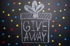 The inscription Giveaway is written on the blackboard, Free distribution, bloggers and gifts, instagram, social network royalty free stock photography