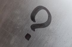 The inscription on glass, question mark concept. Question sign is painted on the surface of misted and wet window stock photos