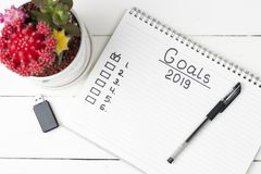 Inscription Goals in a notebook, close-up, top view, concept of planning, setting purpose stock photo