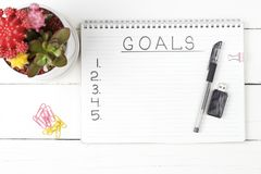 Inscription Goals in a notebook, close-up, top view, concept of planning, setting purpose royalty free stock images