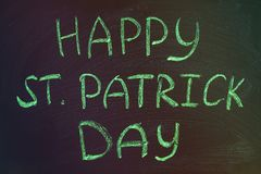 The inscription with green chalk on a chalkboard: Happy St. Patrick's Day Royalty Free Stock Photography