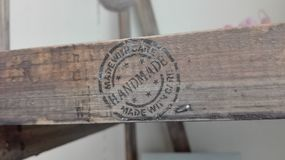 The inscription `handmade with care` on a piece of wood furniture stock photo