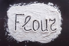 The inscription of the hands on the flour Royalty Free Stock Photography