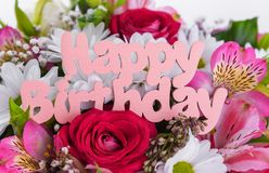 Inscription is Happy Birthday on the flowers. Beautiful festive composition royalty free stock images