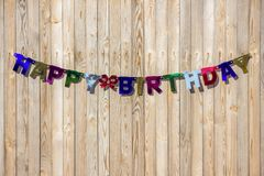 The inscription Happy Birthday from multi-colored letters hangs. On a fence Stock Images