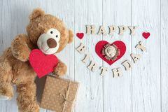 Inscription Happy Birthday. Toy bear, boxes with gifts and a congratulatory inscription happy birthday. Birthday