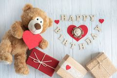 Inscription Happy Birthday. Toy bear, boxes with gifts and a congratulatory inscription happy birthday. Birthday greeting card