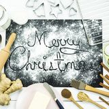 Merry Christmas. written on a black board sprinkled with flour. Christmas cooking concept Royalty Free Stock Images