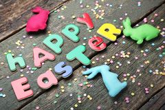 Inscription Happy Easter with rabbits Royalty Free Stock Photo