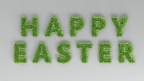 Inscription Happy easter with spring green grass texture on grey Royalty Free Stock Photography