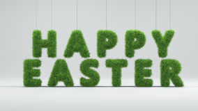 Inscription Happy easter with spring green grass texture on grey Stock Photography