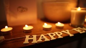 The inscription `Happy Ever After` on the table and the candles. The inscription Happy Ever After on the table and the candles. Wedding decorations. Wedding in stock video
