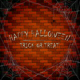 Inscription Happy Halloween on brick wall background with cobweb Royalty Free Stock Photography