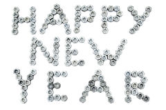 Inscription of happy new year from screw-nuts. Inscription of happy new year from corrosion-proof screw-nuts  on the white isolated background Stock Photo