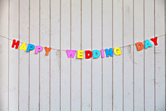 Inscription Happy wedding day on wooden fence Royalty Free Stock Photography