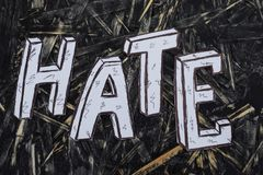 Inscription, hate, on hernom background with white letters stock images