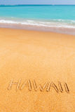 "Inscription ""Hawaii"" made on beautiful beach. Inscription ""Hawaii"" made on beautiful beach by the blue sea Stock Photography"