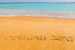 Inscription 'Hawaii 2017' made on beautiful beach Stock Photos