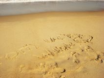 Inscription and heart on the sand beach, ocean royalty free stock photography