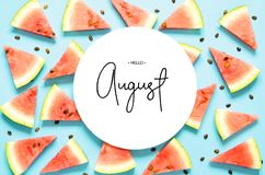 Free Inscription Hello August. Fresh Red Watermelon Slice Isolated Light Blue Background. Top View, Flat Lay. Royalty Free Stock Image - 153354376