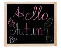 The inscription 'Hello Autumn' written on a blackboard in a wooden frame, royalty free stock image