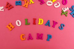 The inscription is `holidays camp` on a pink background stock photo