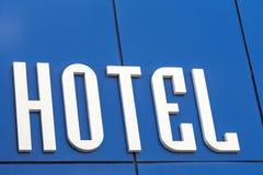 Inscription hotel on blue wall. Stock Photo