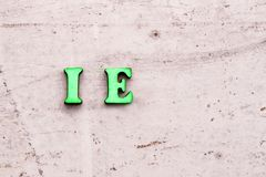 Inscription I.E. ID EST that is abbreviation in wooden letters on a light background.  royalty free stock images