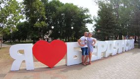 Inscription I love Berdyansk. UKRAINE, BERDYANSK - Jule 19, 2019: Tourists take pictures near the inscription I love Berdyansk on Jule 2019 in Ukraine stock video