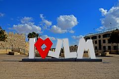 The inscription `I love Jerusalem`, a sculpture decor in the street against the background of old city of Jerusalem, Israel. The inscription `I love Jerusalem` royalty free stock photography